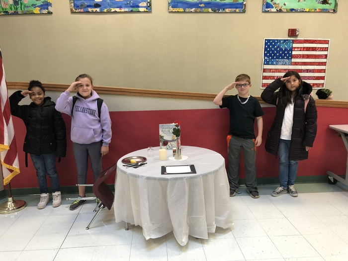 Students stand eager to learn more about the POW/MIA table.