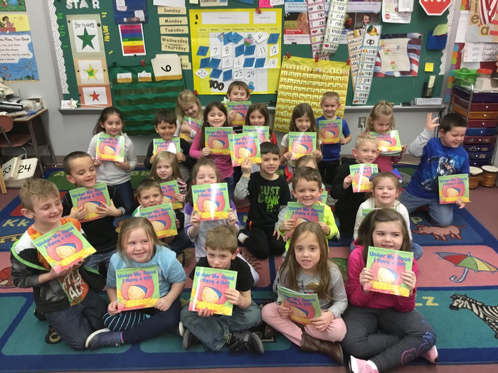 Mr. Haegen's class enjoys reading their new book donated by the Scholastic Book Sponsorship Program!