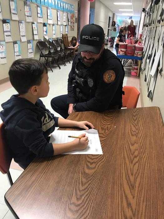 Officer Collins helping student