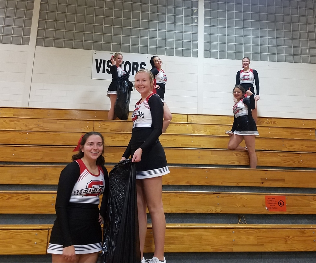 cheerleaders picking up trash